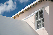 Louvred shutter shading the window of a house in St George Bermuda