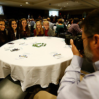 Thomas Wells | Buy at PHOTOS.DJOURNAL.COM<br /> Bruce Ingram of Kossuth grabs a quick photo of some of the girls from the Kossuth High School Cross Country Team who best Class 3A Girls team during Thursday's 2016 Fall Sports Banquet in Tupelo.