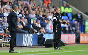 Bolton Wanderers First Team Manager Neil Lennon signals for calm during the Sky Bet Championship match between Bolton Wanderers and Brighton and Hove Albion at the Macron Stadium, Bolton, England on 26 September 2015.