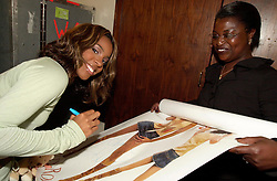 Kelly Rowland signing autographs back stage before getting changed for her solo show at Sheffield City Hall<br />