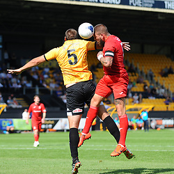 TELFORD COPYRIGHT MIKE SHERIDAN Shane Sutton of Telford battles for a header with Ryan Astles of Southport during the National League North fixture between Southport and AFC Telford United at Haig Avenue on Saturday, August 24, 2019<br /> <br /> Picture credit: Mike Sheridan<br /> <br /> MS201920-005
