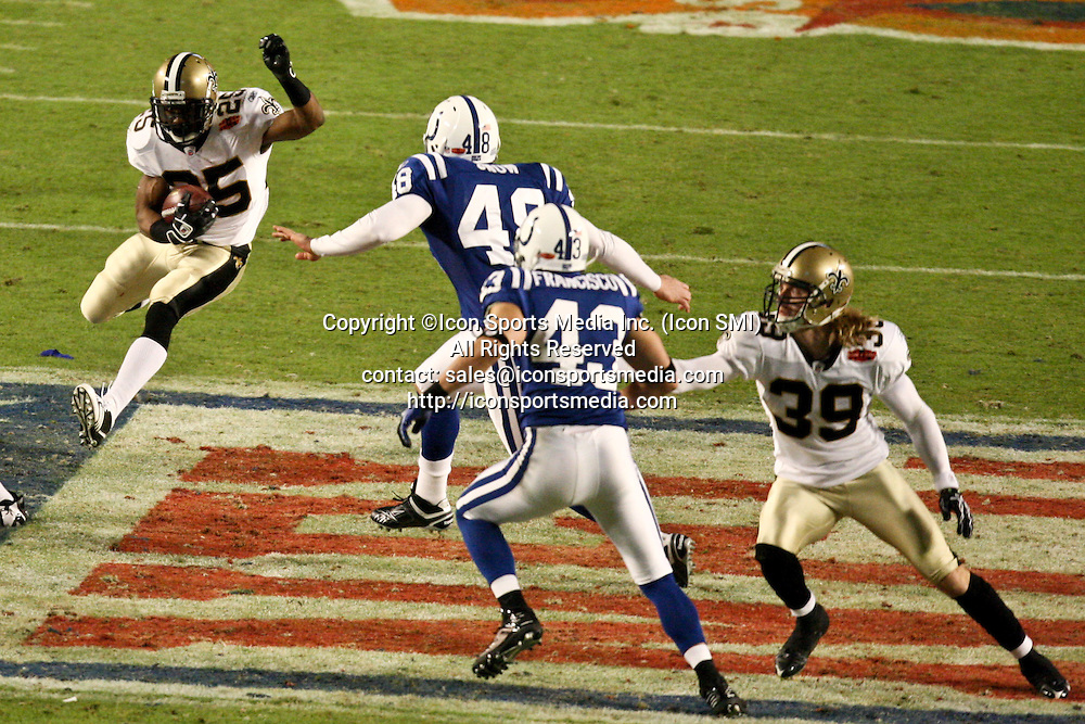 2010 February 07: New Orleans Saints running back Reggie Bush (25) returns a punt against the Indianapolis Colts during a 31-17 win by the New Orleans Saints over the Indianapolis Colts in Super Bowl XLIV at Sun Life Stadium in Miami, Florida.