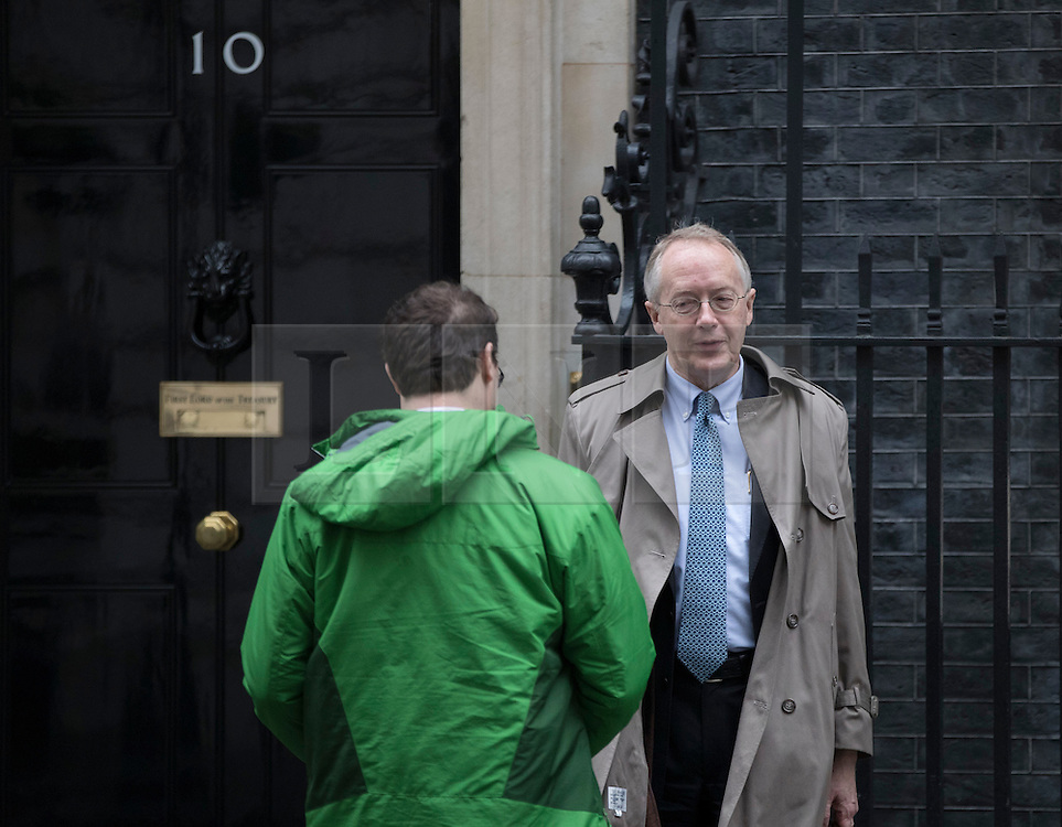 © Licensed to London News Pictures. 31/01/2017. London, UK. Myron Ebell (R) US President Trump's environment advisor, talks to an aide as he leaves number 10 Downing Street after meeting with government officials.  Photo credit: Peter Macdiarmid/LNP
