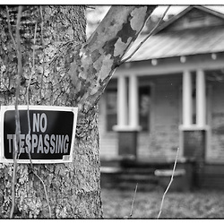 A common sign in the old south.  As more land and homes are abandoned the more ubiquitous these signs become.