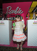 """Sydney """"Mayhem"""" Keiser, founder of Fashion by Mayhem, poses with her one-of-a-kind Barbie at the Variety Power of Women event, Friday, April 24, 2015, in  New York, where she was honored as a """"Shero.""""  Sydney, along with Ava DuVernay, Emmy Rossum, Eva Chen, Kristin Chenoweth and Trisha Yearwood, are the first ever Barbie Sheroes, which celebrates women who are inspiring girls.  (Photo by Diane Bondareff/Invision for Barbie/AP Images)"""