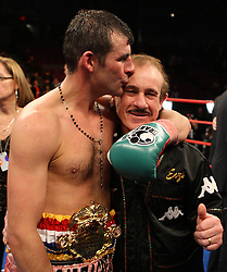 File photo dated 08-11-2008 of Wales' Joe Calzaghe celebrates his points victory over USA's Roy Jones with his father and trainer Enzo