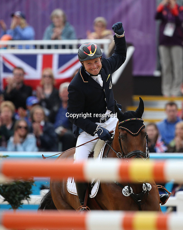31.07.2012. Greenwich Park, London England. Michael Young of Germany Celebrates After The Jumping Final of Equestrian Individual Eventing AT The London 2012 Olympic Games in London  Michael Young of Germany claimed The Title of  Individual Eventing Gold