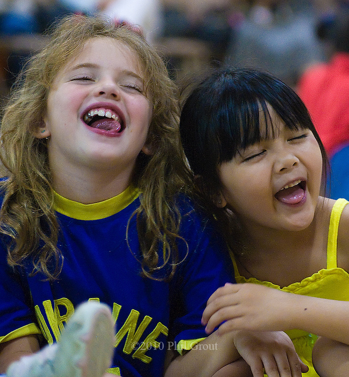 Photo by Phil Grout..Two buddies, Rachel Gertzenov (left) of the Ukraine, and Julia.Sedano of the Philippines, share a good laugh over a great story..It was all part of Diversity Day at the Wellwood International School.and special stories told by Robert Kikuchi-Yngojo.