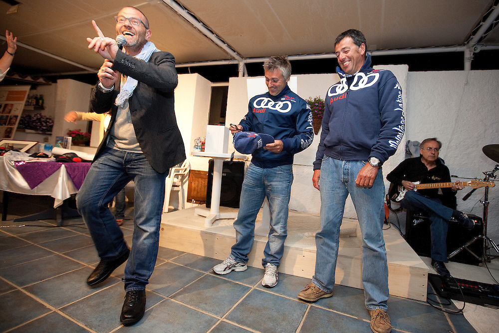Mascalzone Latino team members Albi Barovier and Flavio Favini get involved in a charity auction at the Louis Vuitton Trophy, La Maddalena, Italy. 1 June 2010. Photo: Gareth Cooke/Subzero Images