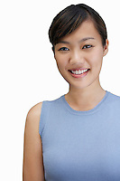Portrait of young woman smiling against white background