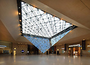 La Pyramide Inversee, or the Inverted Pyramid, designed by architect I M Pei, and installed in 1993, a skylight in the Carrousel du Louvre, a shopping mall underneath the Musee du Louvre, in the 1st arrondissement of Paris, France. A smaller stone pyramid sits directly underneath, their tips almost touching. Picture by Manuel Cohen
