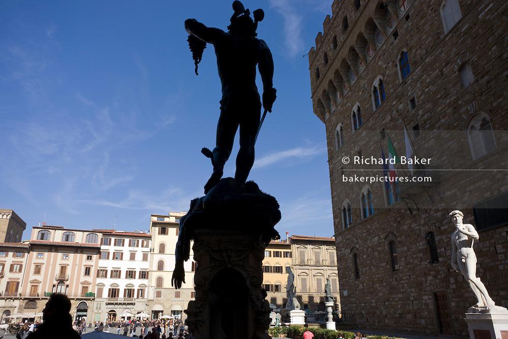 Benvenuto Cellini's Perseus with the Head of Medusa and Michelangelo's David in Piazza della Signoria