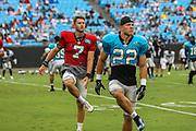 Carolina Panthers quarterback Kyle Allen (7),running back Christian McCaffrey (22)  warming up during Fan Fest at Bank of America Stadium, Friday, Aug. 2, 2019, in Charlotte, NC. (Brian Villanueva/Image of Sport)