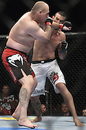 """LONDON, ENGLAND, OCTOBER 2010: Rob Broughton (left) and Vinicius Queiroz trade blows during """"UFC 120: Bisping vs. Akiyama"""" inside the O2 Arena in Greenwich, London"""