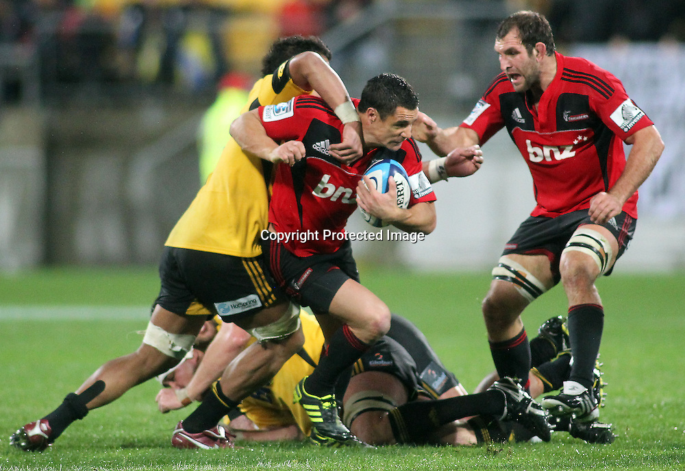 Dan Carter is caught in a tackle by Faifili Lavave. Super Rugby - Crusaders v Hurricanes at Westpac Stadium, Wellington, New Zealand on Saturday 18th June 2011. PHOTO: Grant Down / photosport.co.nz