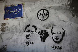 "Graffiti in the Imbaba area of Cairo against candidates Amr Moussa (left) and Ahmed Shafiq, who are criticised here as being ""felool"" (remnants of the old regime).."