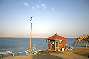 israeli flag floating above a shack at a dead sea resort