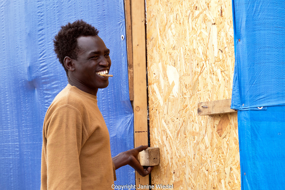 Portrait of young Sudanese man chewing  Khat in The Calais Jungle Refugee and Migrant Camp in France