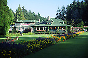 large house, now restaurant, flower beds; green grass; Buchart Gardens; Vancouver Island; British Columbia; Canada