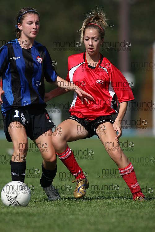 (Ottawa, ON---16 August 2008) The Dixie Dragons (blue and black stripe) playing the Bramptom Brams United Blaze (red) in the 2008 Ontario Summer Games girls soccer final. The Bramptom Brams United Blaze won the game 2-1 in regular time. Photograph copyright Sean Burges/Mundo Sport Images (www.mundosportimages.com).