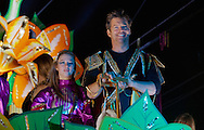 Harry Connick Jr. and his daughter ride on a float with the Krewe of Orpheus during Mardi Gras 2012 in New Orleans