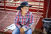 "01 SEPTEMBER 2011 - ST. PAUL, MN:  A high school student with a broken arm behind the chutes of the high school rodeo at the Minnesota State Fair. The Minnesota State Fair is one of the largest state fairs in the United States. It's called ""the Great Minnesota Get Together"" and includes numerous agricultural exhibits, a vast midway with rides and games, horse shows and rodeos. Nearly two million people a year visit the fair, which is located in St. Paul.  PHOTO BY JACK KURTZ"