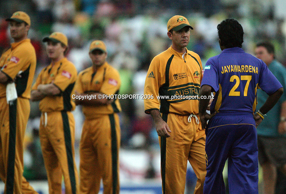 The Australian captain Ricky Ponting talks to his counterpart Mahela Jayawardene towards the end of the match about finishing the overs at the 2007 ICC Cricket World Cup Final between Australia and Sri Lanka at Kensington Oval, Barbados, West Indies on Saturday 28 April 2007. Australia won the toss and elected to bat first and won the match by 53 runs. Photo: Andrew Cornaga/PHOTOSPORT<br />