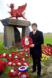 FLANDERS, BELGIUM - Monday, November 17, 2014: Wales' manager Chris Coleman with a wreath from the FAW at the war memorial to the Welsh soldiers at Flanders Field in Belgium. (Pic by David Rawcliffe/Propaganda)