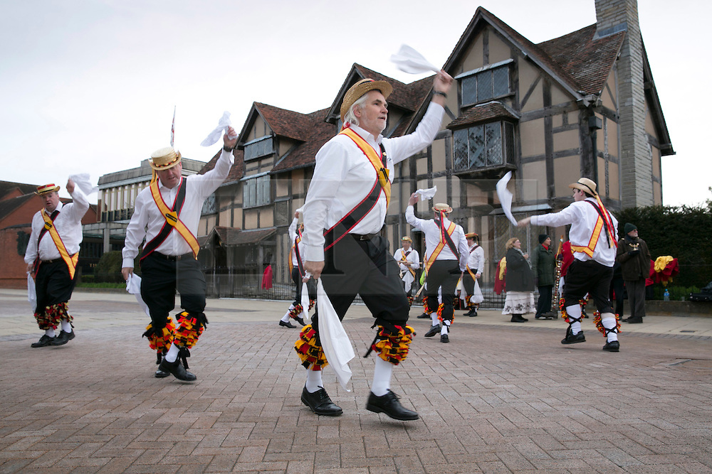 """© Licensed to London News Pictures. 01/05/2015. Stratford upon Avon, Warwickshire, UK. The Shakespeare Morris Men """"Dance in the Dawn"""" outside the Shakespeare Birthplace in the centre of Stratford upon Avon on the first day of May. Photo credit : Dave Warren/LNP"""