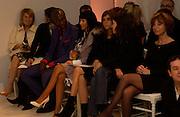 Ozwald Boateng and Christina Aguilera, Givenchy couture show, Julian Macdonald's last ( ?)  Paris, 20 January 2004. © Copyright Photograph by Dafydd Jones 66 Stockwell Park Rd. London SW9 0DA Tel 020 7733 0108 www.dafjones.com