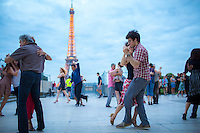 Paris, France - July 15, 2014: Ballroom dancers lose themselves in the moment at the Trocadero across the Seince from the Eiffel Tower. CREDIT: Chris Carmichael for The New York Times