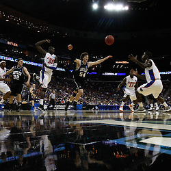 Mar 26, 2011; New Orleans, LA; Butler Bulldogs forward Matt Howard (54), Florida Gators center Vernon Macklin (32) and guard Kenny Boynton (1) scramble for a loose ball during the first half of the semifinals of the southeast regional of the 2011 NCAA men's basketball tournament at New Orleans Arena.   Mandatory Credit: Derick E. Hingle