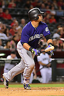 Apr 29, 2016; Phoenix, AZ, USA; Colorado Rockies left fielder Gerardo Parra (8) hits an RBI double in the eighth inning against the Arizona Diamondbacks at Chase Field. Mandatory Credit: Jennifer Stewart-USA TODAY Sports