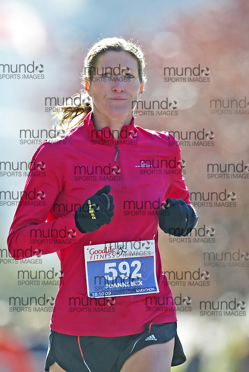 "(Toronto, Ontario -- 18 Oct 2009)   JOANNE BINK runs to second place in the Goodlife Fitness Toronto Marathon. [Photo credit should read ""Sean Burges / Mundo Sport Images""]"