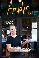 A waitress serving up fresh paella at Andaluz in Salem, Oregon