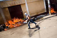 A man throws a Molotov cocktail at the mayors office Tuesday Sept. 11, 2007, Palin Guatemala. A angry mob took to the streets and went on to burn down the mayors office as well as his home in demonstration after and clash with local police on the previous day. Residents accuse the mayor of, among other things, of bussing voters for the elections on Sept. 9 2007.   (photo by/ Darren Hauck)..............