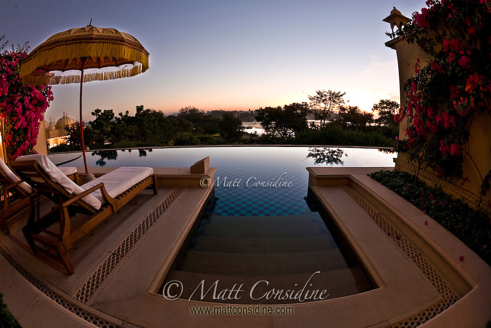 A peaceful morning view over the pool and Lake Pichola from a room in the Oberoi Udaivilas.<br /> (Photo by Matt Considine - Images of Asia Collection)