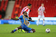 42 Anthony Grant for Shrewsbury Town challenges #7 Tom Ince for Stoke City during the The FA Cup 3rd round replay match between Stoke City and Shrewsbury Town at the Bet365 Stadium, Stoke-on-Trent, England on 15 January 2019.