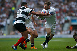 Elliot Daly of England is challenged by Josh Matavesi of Barbarians - Mandatory by-line: Ryan Hiscott/JMP - 27/05/2018 - RUGBY - Twickenham Stadium - London, England - England v Barbarians - Quilter Cup