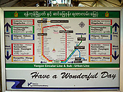 25 NOVEMBER 2017 - YANGON, MYANMAR: The route of the Yangon Circular Train on a sign in the Yangon Central Railroad Station. The Yangon Circular Train is a 45.9-kilometre (28.5 mi) 39-station two track loop system connects satellite towns and suburban areas to downtown. The train was built during the British colonial period, the second track was built in 1954. Trains currently run both directions (clockwise and counter-clockwise) around the city. The trains are the least expensive way to get across Yangon and they are very popular with Yangon's working class. About 100,000 people ride the train every day. A a ticket costs 200 Kyat (about .17¢ US) for the entire 28.5 mile loop.    PHOTO BY JACK KURTZ