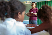 A teacher speaks to students during class at the primary school in the town of Coyolito, Honduras on Wednesday April 24, 2013.