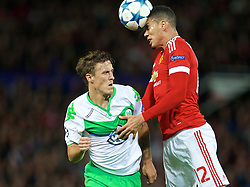 MANCHESTER, ENGLAND - Wednesday, September 30, 2015: Manchester United's Chris Smalling in action against VfL Wolfsburg's Max Kruse during the UEFA Champions League Group B match at Old Trafford. (Pic by David Rawcliffe/Propaganda)
