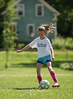 McKenzie practices her foot skills with On Goal Soccer Camp at Leavitt Park on Thursday morning.  (Karen Bobotas/for the Laconia Daily Sun)