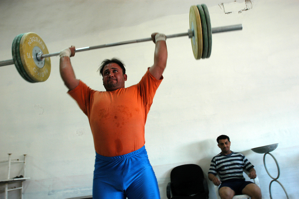 Members of the Iraqi national weight lifting team training for the 2004 Athens Olympics. Two weightlifters will be representing Iraq at the Olympic Games for the first time in decades..Baghdad, Iraq. 17/04/2004.Photo © J.B. Russell