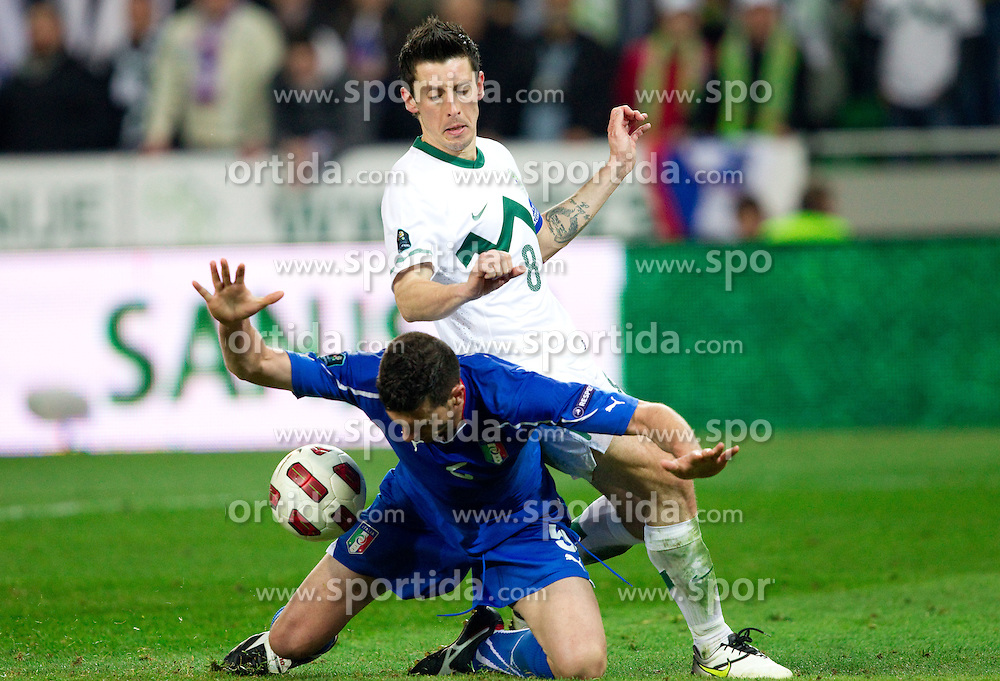 Thiago Motta of Italy and Robert Koren of Slovenia during EURO 2012 Quaifications game between National teams of Slovenia and Italy, on March 25, 2011, SRC Stozice, Ljubljana, Slovenia. Italy defeated Slovenia 1-0.  (Photo by Vid Ponikvar / Sportida)