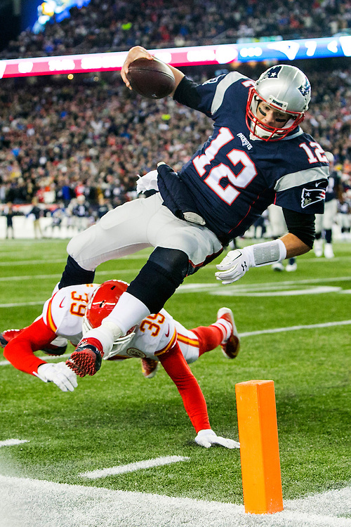 New England Patriots quarterback Tom Brady (12) gets knocked off his feet by Kansas City Chiefs safety Husain Abdullah (39) as he reaches for the pylon in the second quarter of the AFC Divisional Playoff game at Gillette Stadium in Foxborough, Massachusetts on January 16, 2016. The play was reviewed and called just short of the goal line, though the Patriots scored on the following play.    Photo by Kelvin Ma/ UPI