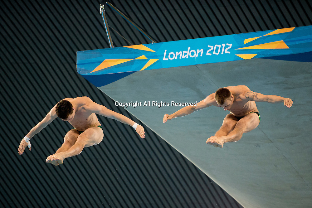 30.07.2012. London, England. Germanys Patrick HAusding (GER) and Sascha Klein (GER) compete in the Mens Synchronised 10m Platform Diving Final on Day 3 of the London 2012 Olympic Games at the Aquatics Centre on the Olympic Park.