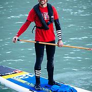 Portrait of Chris Theobald stand up paddle boarding in Bernardo O'Higgins National Park, Chile.