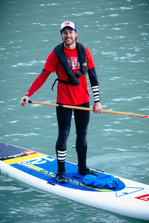 Portrait of Chris Theobald stand up paddle boarding in Bernardo O'Higgins National Park, Chile.