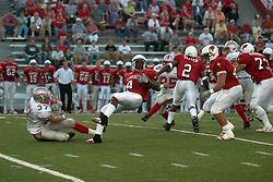 02 September 2004    Pierre Jackson slips on the turf. St. Xavier Cougars at Illinois State University Redbirds.  Hancock Stadium.  Normal IL